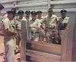 GROUP OF MEN OBSERVING CONSTRUCTION