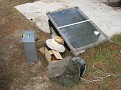 A simple home made solar collection device for melting and collecting bees wax.