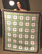 Paige with her quilt